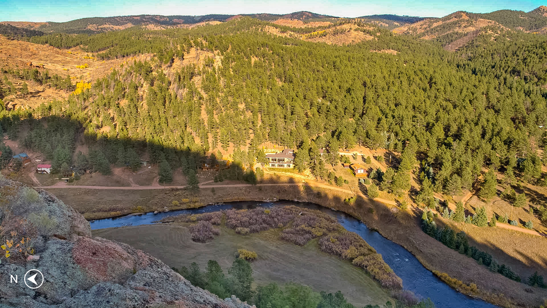 Aerial view of the home at 940 East Platte Road located in the gated community of Sportsmen's Paradise in Lake George, CO. Photo taken from Etch A Sketch Rock across the South Platte River along the trail of the same name.